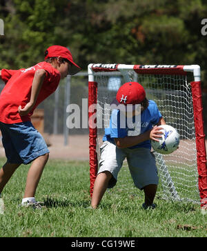 Dominic Albanese keeps the ball from Matthew Weir, both of Pleasanton, during a soccer game at Quest Camp in Alamo, - Stock Photo