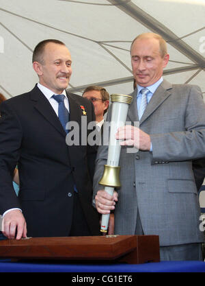 Vladimir Putin Visiting The Klimov Aircraft Engine Factory in St.Petersburg. President Vladimir Putin holding the - Stock Photo