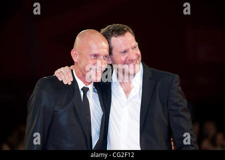 Sept. 8, 2011 - Venice, Italy - from left to right actors Anton Adasinskiy and Johannes Zeiler on the red carpet - Stock Photo