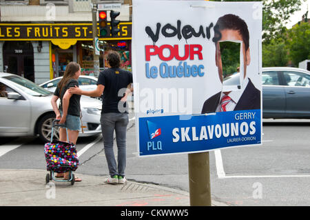 23rd Aug 2012. Here the face was cut out and the slogan of the Liberal Party of Quebec candidate was transformed - Stock Photo