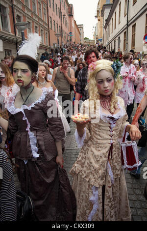 Zombies at Stockholm Zombie Walk 2012. Here two zombie women dressed in old clothing. - Stock Photo