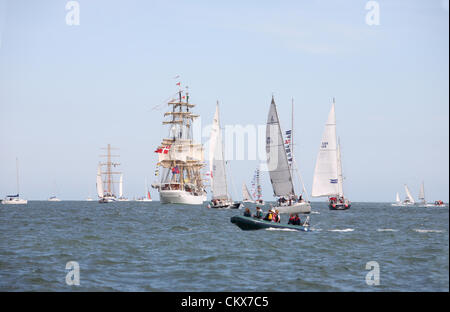 26th Aug 2012. After three days in port finally the tall ships have a tremendous send off as they leave Dublin Bay, - Stock Photo