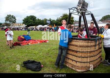 26th Aug 2012. The John Harris (G-CDWD)  University of Bristol balloon is prepared for launch at the Tiverton balloon festival in Tiverton, Devon, UK.