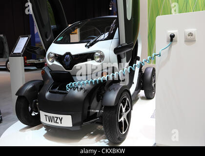 DUESSELDORF - AUGUST 27: Electric car Renault Twizy at the Caravan Salon Exhibition 2012 on August 27, 2012 in Düsseldorf, - Stock Photo