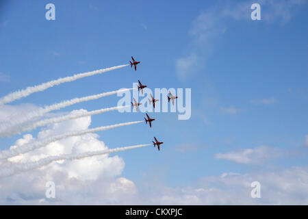 The Red Arrows, flying in formation over Poole Bay, Bournemouth, Dorset, England, UK. - Stock Photo
