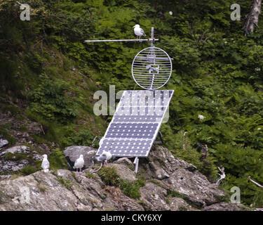 July 1, 2012 - Alaska, US - Radio antenna are mounted on several large rock islands that serve as Stellar Sea Lion - Stock Photo
