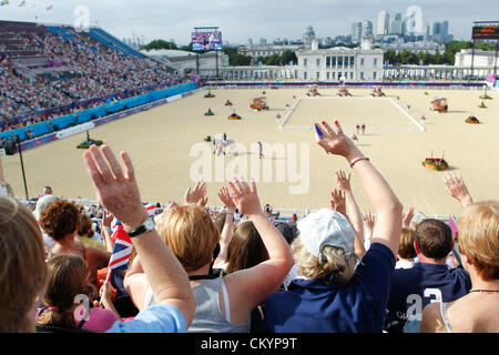 Fans at Greenwich Park equestrian venue cheer silently for horses, riders in Individual dressage 1A at the London - Stock Photo