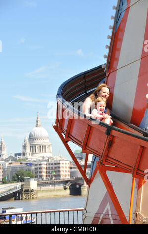Southbank, London, UK. 8th September 2012. St Paul's in the background, families enjoy a Helter Skelter on the Southbank - Stock Photo