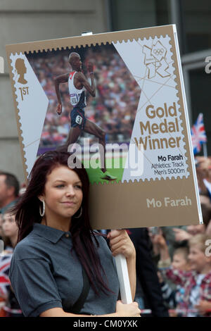 10th September, 2012. London UK. Thousands of spectators line the streets of London to celebrate the achievements - Stock Photo
