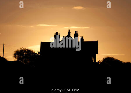Swansea - UK - 13th September 2012 : Glowing autumn dawn sky over the rooftops of Swansea early this morning. Credit: - Stock Photo
