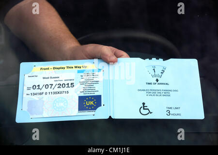Parking card for disabled people (Disabled person's parking disc a valid blue badge permit) UK - Stock Photo