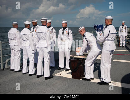 US Navy personnel carry the remains of Apollo 11 astronaut Neil Armstrong during the burial at sea service for her - Stock Photo