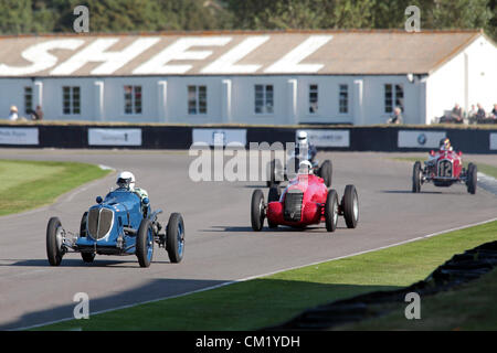 Goodwood Estate, Chichester, UK. 15th September 2012. Robert Newall driving a 1934 Maserati 8CM is chased by Klaus - Stock Photo