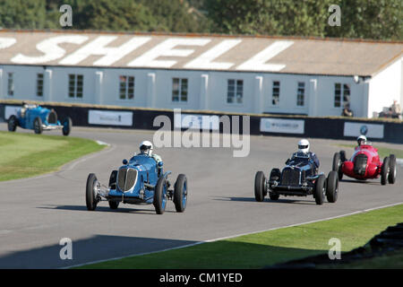 Goodwood Estate, Chichester, UK. 15th September 2012. Robert Newall driving a 1934 Maserati 8CM is chased by Ian - Stock Photo