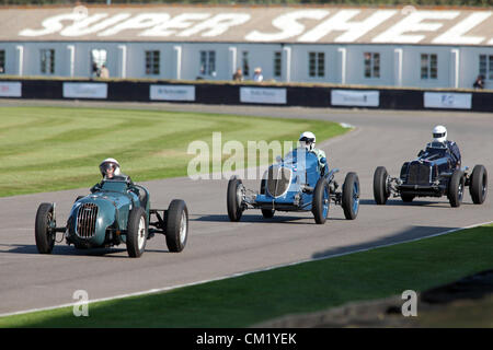 Goodwood Estate, Chichester, UK. 15th September 2012. Paul Jaye (left) driving a 1938 Alta is chased by Robert Newall - Stock Photo