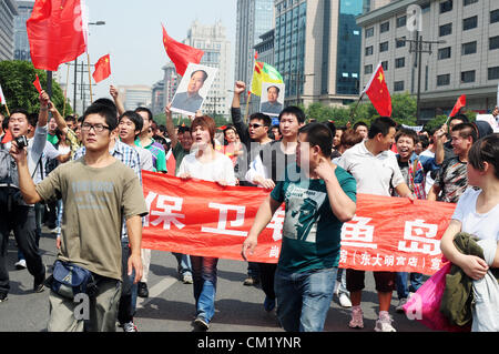 Xian,China. Saturday 15th September, 2012. Anti-Japanese protesters have a demonstration at the gate of Bell Tower - Stock Photo