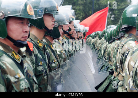 Xian, China. Saturday 15th September, 2012. Armed policemen gather and march to the city center to fight with the - Stock Photo