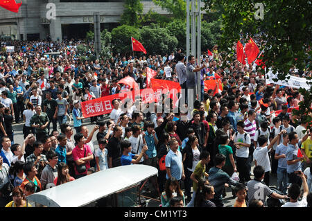 Xian, China. Saturday 15th September, 2012. Anti-Japanese protesters gather during a demonstration at the gate of - Stock Photo