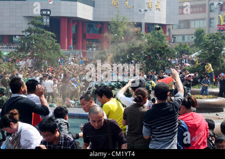 Xian, China. Saturday 15th September, 2012. Anti-Japanese protesters have a conflict with armed police at a demonstration - Stock Photo