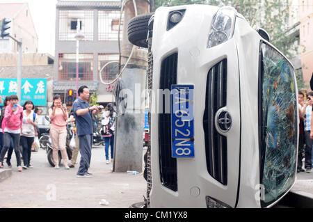 Xian, China. Saturday 15th September, 2012. Anti-Japanese protesters damage and break a Japanese brand TOYOTA  car - Stock Photo