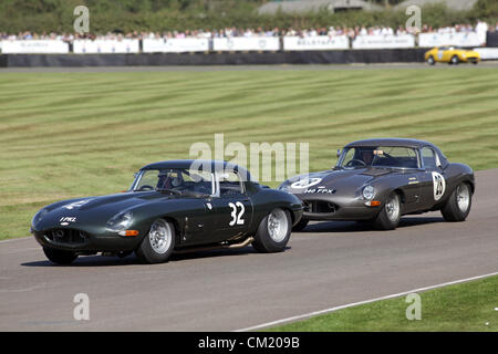 Goodwood Estate, Chichester, UK. 15th September 2012. Rauno Aaltonen drives a 1963 Jaguar E-type, follwed by 1961 - Stock Photo