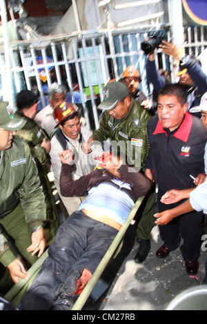 LA PAZ, BOLIVIA, 18th September 2012. A wounded miner who works for the state mining company COMIBOL is evacuated - Stock Photo