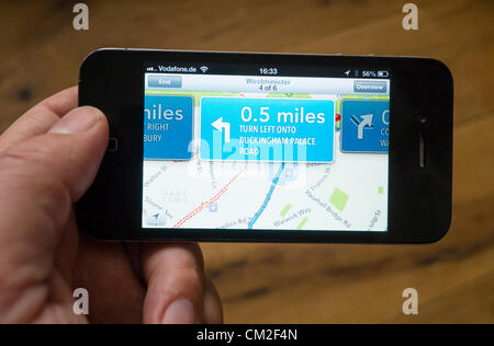 Car navigation with turn-by-turn directions on the new Apple Maps application.  Apple's new Maps application has - Stock Photo