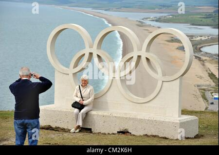 Dorset's Olympic rings given pride of place at the popular viewpoint above Chesil Beach on Portland. One of the - Stock Photo