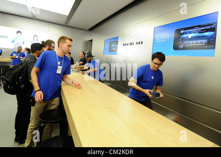 Toronto, Canada. September 21, 2012. Apple's new iPhone 5 goes on sale on Friday September 21, 2012. Employees at - Stock Photo