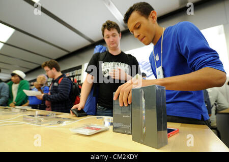 Toronto, Canada. September 21, 2012. Apple's new iPhone 5 goes on sale on Friday September 21, 2012.  Employee at - Stock Photo