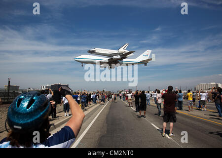 NASA Shuttle Carrier Aircraft carrying space shuttle Endeavour lands at Los Angeles International Airport as hundreds - Stock Photo