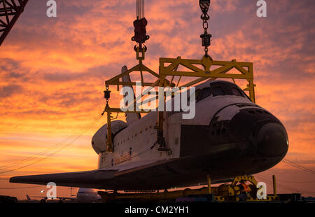 NASA space shuttle Endeavour is removed from the 747 Shuttle Carrier Aircraft and placed on the Over Land Transporter - Stock Photo