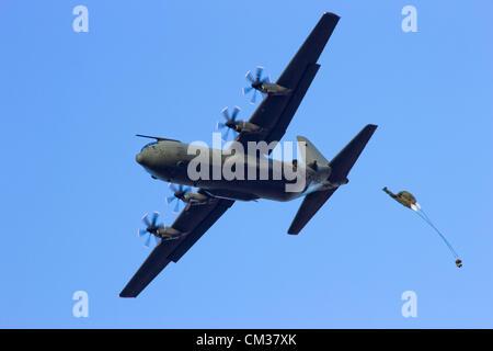 RAF C-130 Hercules plane drops para troopers during the Market Garden Memorial, Ginkelse Heide, The Netherlands, - Stock Photo
