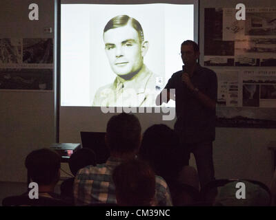 Museum visitors take part in a lecture on this year's Researchers Night theme, Alan Mathison Turing, considered - Stock Photo