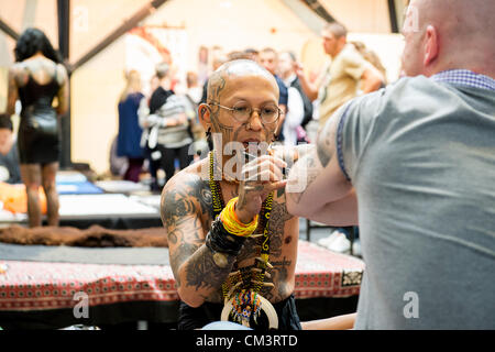 28th September 2012, London, UK. The 8th London Tattoo Convention begins today at Tobacco Dock in the East End of - Stock Photo