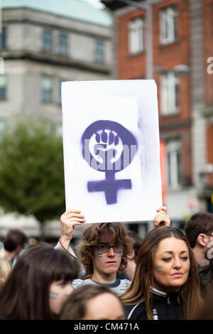 Dublin, Ireland - September 29, 2012: Dublin March for Choice 2012, Young man holding pro-choice activists poster - Stock Photo