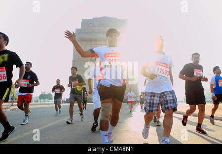 Sep. 30, 2012 - New Delhi, India - Delhi residents participate in the New Delhi Half Marathon as they run by the - Stock Photo