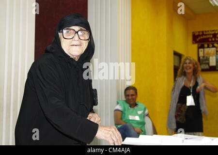 1 October 2012 - Tibilisi, Georgia - An elderly woman casts her vote in a polling station in downtown Tibilisi, - Stock Photo