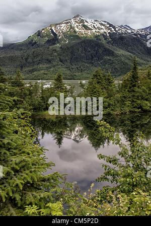 July 5, 2012 - Borough Of Juneau, Alaska, US - Mendenhall Lake, surrounded by the majestic Coast Mountain Range. - Stock Photo