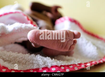 JOHANNESBURG, SOUTH AFRICA: A baby sleeps at the Cotlands Baby Sanctuary on October 16, 2012 in Johannesburg, South - Stock Photo