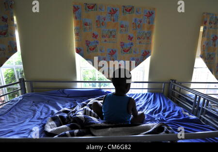 JOHANNESBURG, SOUTH AFRICA: An abandoned child at the Cotlands Baby Sanctuary on October 16, 2012 in Johannesburg, - Stock Photo