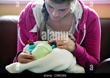 JOHANNESBURG, SOUTH AFRICA: Volunteer Anna Feifel plays with an abandoned baby at the Cotlands Baby Sanctuary on - Stock Photo