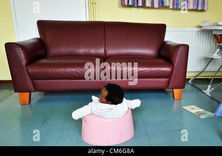 JOHANNESBURG, SOUTH AFRICA: An abandoned baby at the Cotlands Baby Sanctuary on October 16, 2012 in Johannesburg, - Stock Photo
