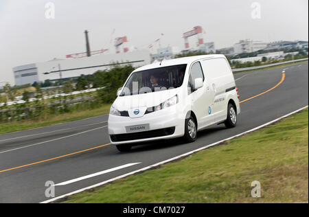 Photo shows a prototype of Nissan's e-NV200 electric vehicle during a test run at the automaker's Oppama test circuit - Stock Photo