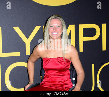 London, UK. October 19th 2012: Guest poses for photos at the 'UK Athletics Dinner' held at the Royal courts of Justice, - Stock Photo