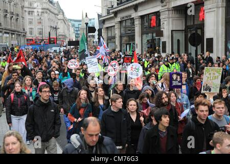 London, UK. 20th October 2012 A large group of protestors gathered in Oxford Circus and marched around central London - Stock Photo