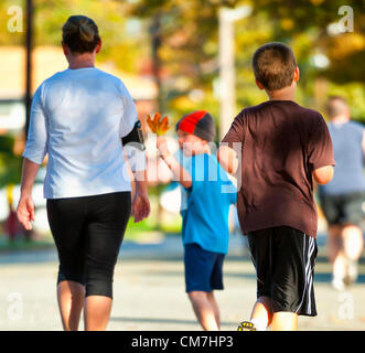 Oct. 21, 2012 - Merrick, New York, U.S. - While running the 5th Annual Blazing Trails for Autism 4 Mile Run for - Stock Photo