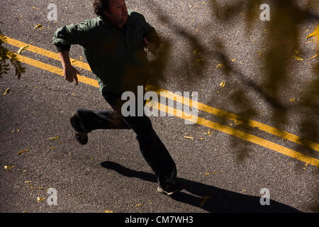 New York, USA. October 22nd 2012. O Positive Films. Actor in a running scene that is filming on location on Wadsworth - Stock Photo