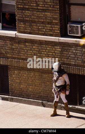 New York, USA. October 22nd 2012. O Positive Films. Actor dressed as an Alien standing on the sidewalk filming an - Stock Photo