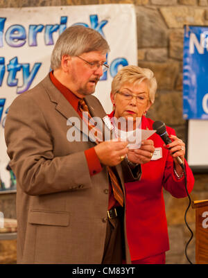 Oct. 23, 2012 - Merrick, New York, U.S. - Congresswoman CAROLYN MCCARTHY (D) in red suit, and JOE BAKER, President - Stock Photo